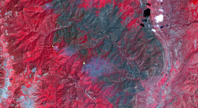 On June 26, 2018, NASA's Terra spacecraft acquired this image of 416 Fire which started June 1, 2018, about 13 miles north of Durango, Colorado. Vegetation in shown red, clouds in white, cities and bare rocky areas in gray, and burned area in dark gray.