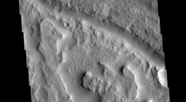 This image from NASA's Mars Odyssey shows a section of martian terrain in Indus Vallis. Indus Vallis is located in Terra Sabaea.