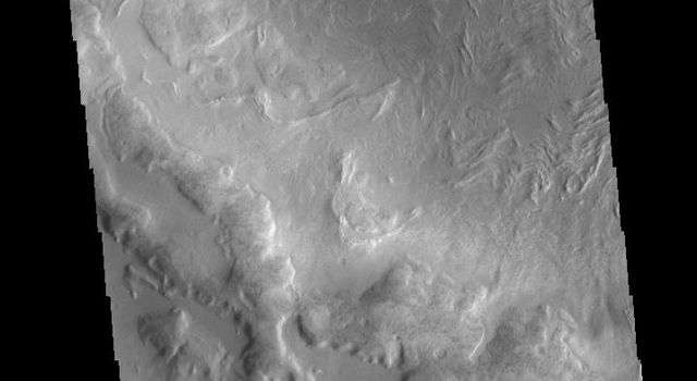 This image from NASA's Mars Odyssey shows an unnamed crater containing a small dune field located in the region between northern Terra Sabaea and Utopia Planitia.