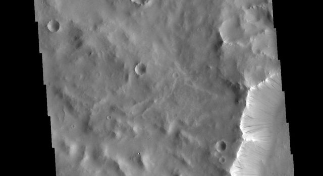 This image from NASA's Mars Odyssey shows a ridge, located in Terra Sabaea, which contains dark slope streaks. These features are thought to form by downslope movement of material.