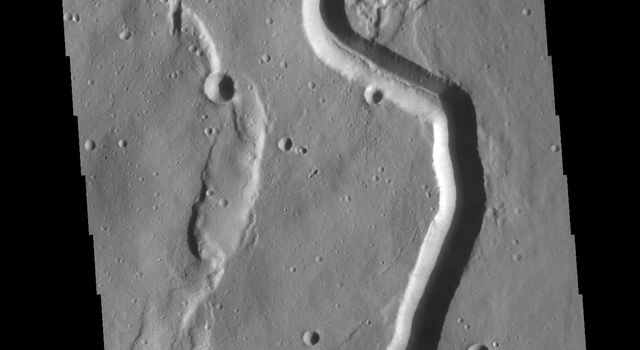This image from NASA's Mars Odyssey shows a portion of Buvinda Vallis, a channel near the flank of Hecates Tholus.