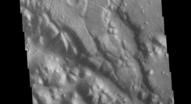 This image from NASA's Mars Odyssey shows shows part of Aram Chaos. Aram Chaos was initially formed by a large impact. Over time the crater interior was modified by several different processes, including liquid water.