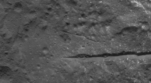 This image of fractures in Occator Crater's floor on Ceres was obtained by NASA's Dawn spacecraft on July 5, 2018 from an altitude of about 35 miles (57 kilometers).