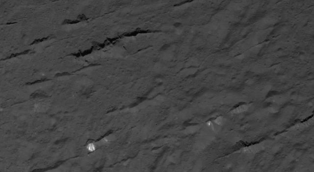This image of fractures across Occator Crater's floor on Ceres was obtained by NASA's Dawn spacecraft on July 4, 2018 from an altitude of about 30 miles (48 kilometers).
