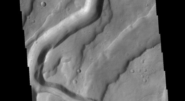 This image from NASA's Mars Odyssey shows Tyrrhenus Mons, one of the oldest Martian volcanoes. Tyrrhena Fossae is the largest of the channels dissecting the volcano.