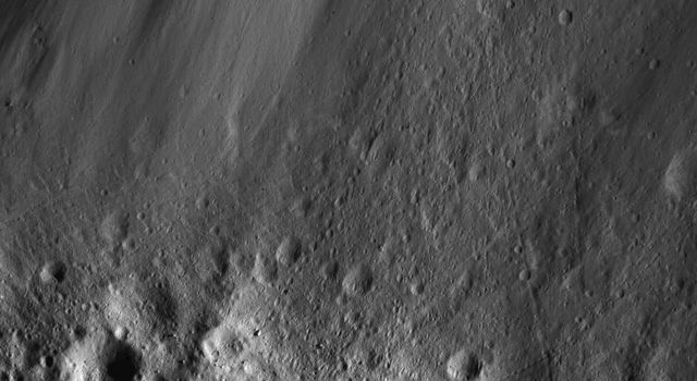 This image from NASA's Dawn spacecraft of boulders along Urvara Crater's wall was obtained from an altitude of about 28 miles (45 kilometers) above Ceres' surface.