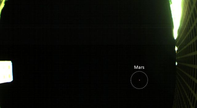 The is the first image of Mars captured by one of NASAs Mars Cube One (MarCO) CubeSats showing both the CubeSats unfolded high-gain antenna at right and Mars just below, acquired by MarCO-B on October 2, 2018.