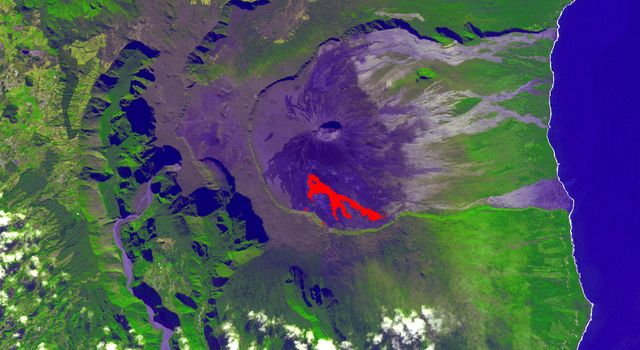 NASAs Terra spacecraft obtained this ASTER image of an eruption from Piton de la Fournaise volcano on Reunion Island in the Indian Ocean. The background image was acquired July 16, 2018, and the thermal image on November 1, 2018.