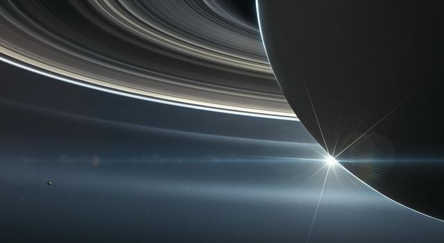 This illustration shows NASAs Cassini spacecraft in orbit around Saturn.