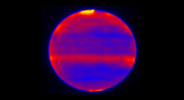 Scientists used red, blue and yellow to infuse this infrared image of Jupiters atmosphere, which was recorded by the Subaru Telescope on the summit of Mauna Kea, Hawaii on Jan. 12, 2017.