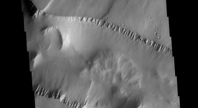 This image from NASAs Mars Odyssey shows Noctis Labyrinthus. There are two directions of faults visible, which intersect at an approximately 90 degree angle.