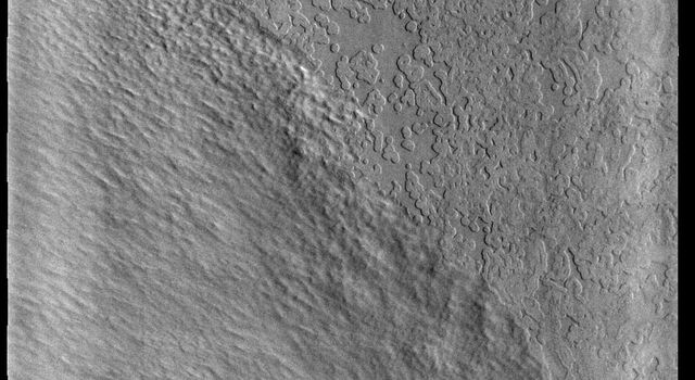 This image from NASAs Mars Odyssey shows several different surface textures in the South Polar ice.