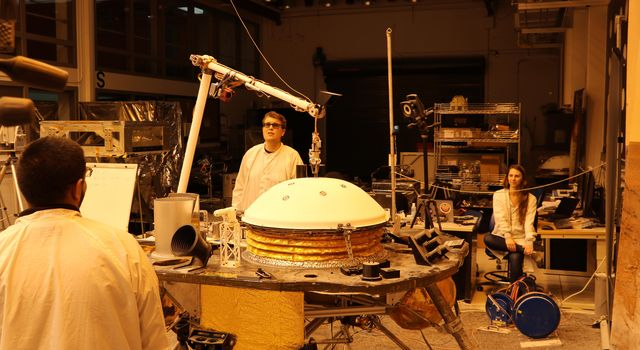 NASAs InSight mission tests an engineering version of the spacecrafts robotic arm in a Mars-like environment at NASAs Jet Propulsion Laboratory.