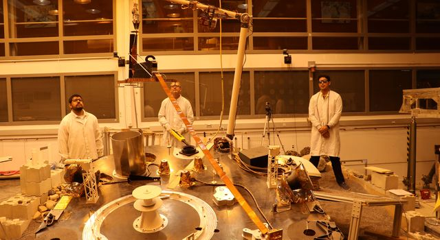 An engineering version of the robotic arm on NASAs InSight mission lifts the engineering version of the Heat Flow and Physical Properties Probe (HP3) at NASAs Jet Propulsion Laboratory.