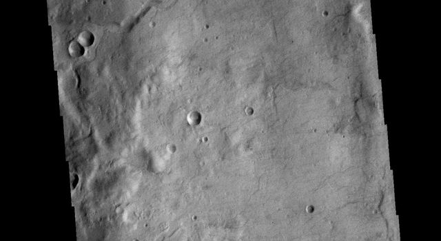 This image from NASAs Mars Odyssey shows a small channel system dissecting the rim of this unnamed crater in Terra Sirenum.