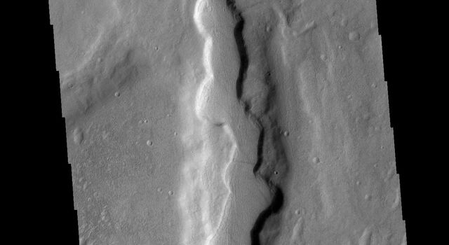 This image from NASAs Mars Odyssey shows one of the numerous channel features that dissect the highlands between Solis Planum and Aonia Terra.