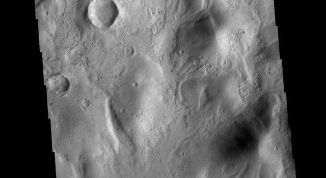 This image from NASAs Mars Odyssey shows several small channels. These channels are along the break in topography, that leads down into Argyre Planitia.