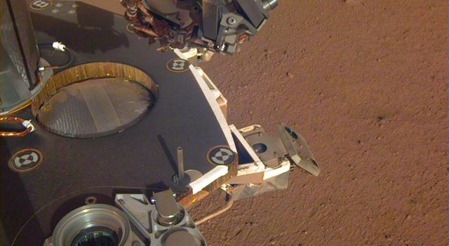 This image shows a partial view of the deck of NASAs InSight lander, where it stands on the Martian plains Elysium Planitia.