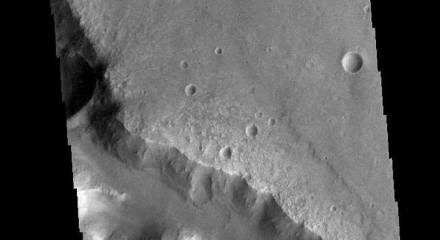 This image from NASAs Mars Odyssey shows a section of Her Desher Vallis. This channel is located in Noachis Terra.