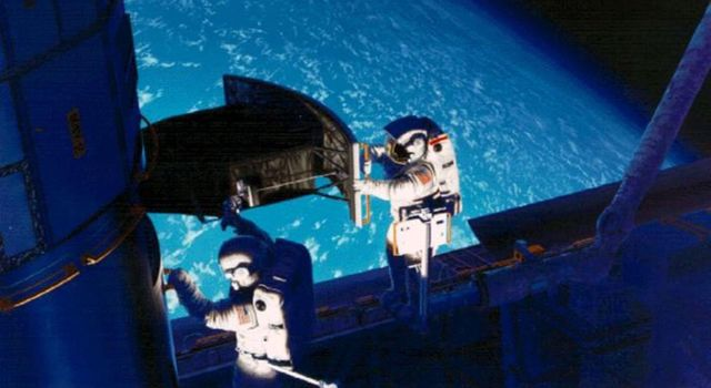 This image of NASAs Hubble Space Telescope shows Astronaut Jeffrey Hoffman and Story Musgrave installing the Wide Field and Planetary Camera 2 (WFPC2) on the Hubble Space Telescope, during SM1 in December, 1993.