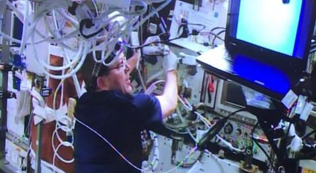 This image shows astronaut Ricky Arnold assisting with the installation of NASAs Cold Atom Laboratory on the International Space Station.