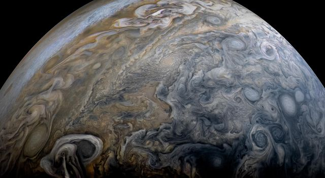 NASAs Juno spacecraft captured this stunning Jovian cloudscape, as the spacecraft performed its 11th close flyby of Jupiter.