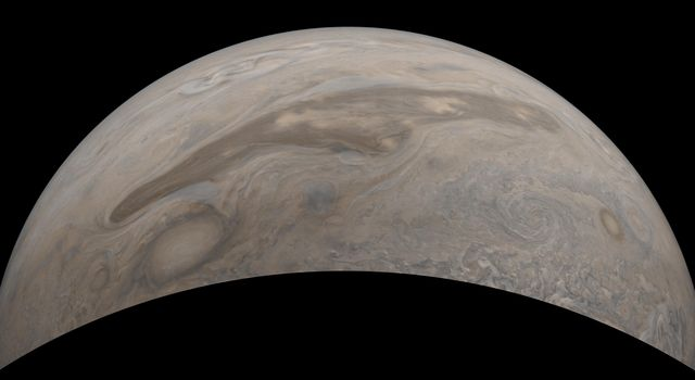 The southern edge of Jupiters north polar region is captured in this view from NASAs Juno spacecraft.