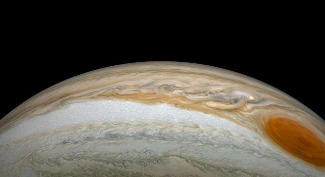 NASAs Juno spacecraft saw this striking vista during its most recent close flyby of Jupiter.