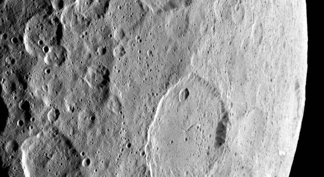 This image, highlighting the complex set of fractures near the center of the large Ezinu Crater on Ceres, was obtained by NASAs Dawn spacecraft on September 2, 2018 from an altitude of about 2095 miles (3070 kilometers).