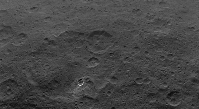 This image shows Haulani Crater and its bright ejecta near the limb of Ceres and Oxo Crater, as obtained by NASAs Dawn spacecraft on September 1, 2018 from an altitude of about 2075 miles (3340 kilometers).
