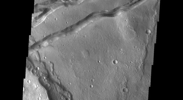 This image from NASAs Mars Odyssey shows linear features called graben. Graben are formed when blocks of material move downward between parallel faults.