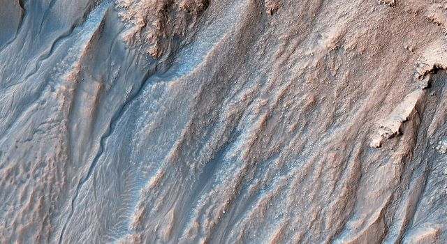This image acquired on October 28, 2018 by NASAs Mars Reconnaissance Orbiter, shows that gullies probably formed along the bouldery layers in the upper slopes of this unnamed crater.