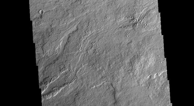 This image from NASAs Mars Odyssey shows a small portion of the extensive volcanic plains of Daedalia Planum.