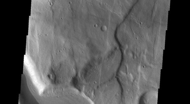 This image from NASAs Mars Odyssey shows a section of an unnamed channel. This channel starts within Claritas Fossae and empties down hill into Icaria Planum.