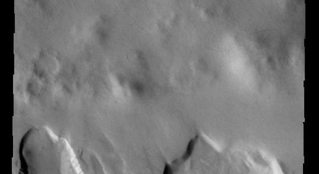 This image from NASAs Mars Odyssey shows part of an unnamed crater in Noachis Terra. Several craters in the southern hemisphere contain floor fill that has subsequently been eroded to form depressions in the fill material.