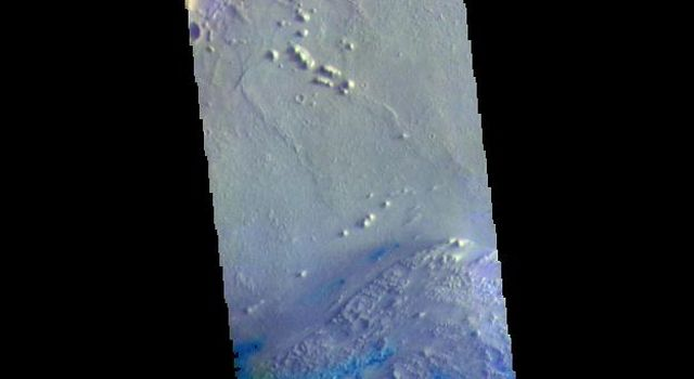 This image from NASAs Mars Odyssey shows part of the floor of Pasteur Crater. The deposit in the southwest part of the floor is a fill deposit that is undergoing erosion.
