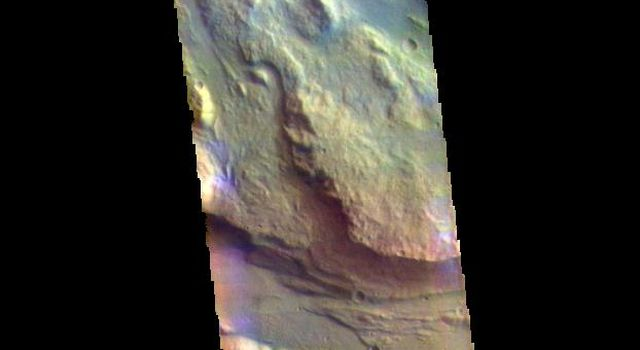 This image from NASAs Mars Odyssey shows several channel features. Towards the top of the image are several stream-lined islands, created by liquid flow eroding preexisting rock.