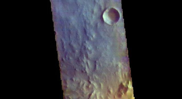 This image from NASAs Mars Odyssey shows an area in Arabia Terra. The crater at the bottom of the image contains a large region of sand dunes.