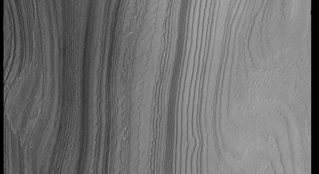 This image from NASAs Mars Odyssey shows layering in the south polar cap.