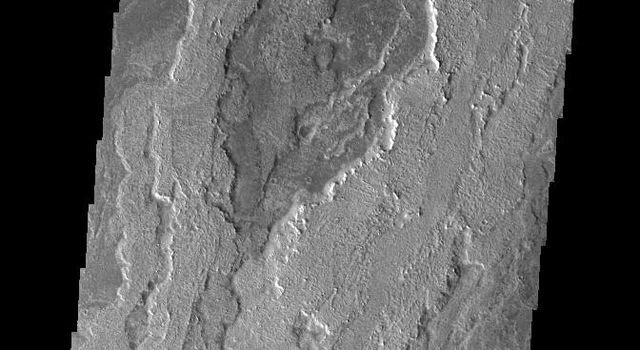 This image from NASAs Mars Odyssey shows a small portion of Daedalia Planum. The lava flows in this image originated at Arsia Mons.