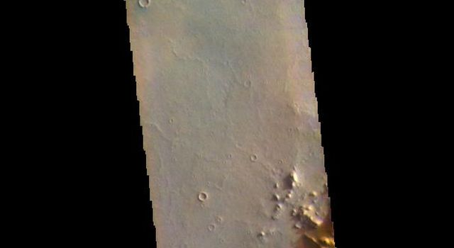 This image from NASAs Mars Odyssey shows an area in Arabia Terra.