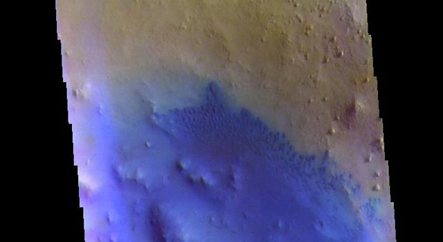 This image from NASAs Mars Odyssey shows an unnamed crater in Arabia Terra. Dark blue in this combination is typically basaltic sands.