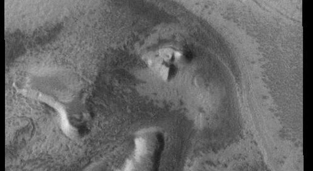 This image from NASAs Mars Odyssey is located near the south polar cap and exhibits the same layering of ice and dust.
