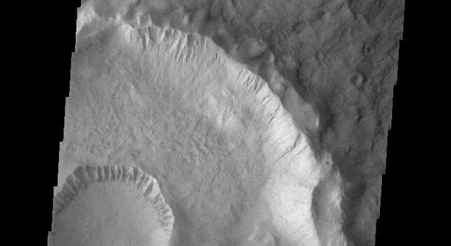 This image from NASAs Mars Odyssey shows Gasa Crater located on the floor of a larger unnamed crater Eridania Planitia.