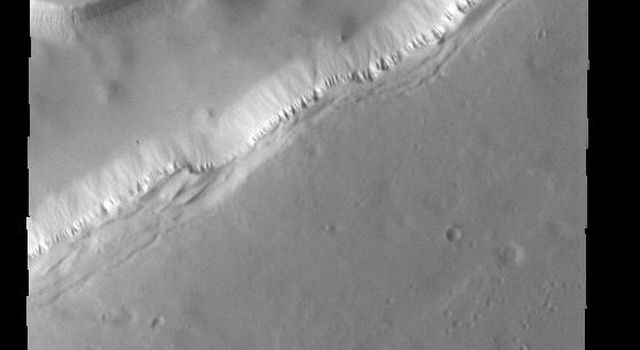 This image from NASAs Mars Odyssey shows part of Sisyphi Cavi located in Noachis Terra near the south polar cap.