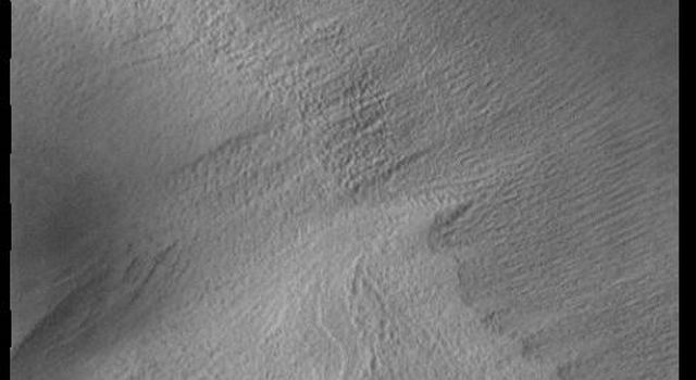 This image from NASAs Mars Odyssey shows part of the south polar cap. The cap is comprised of layers of ice and dust deposited over millions of years.