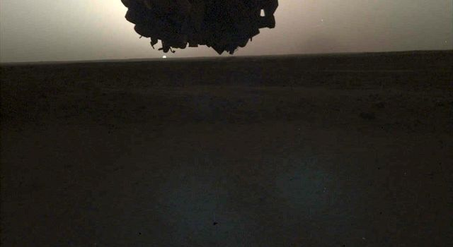 NASAs InSight lander used its Instrument Deployment Camera (IDC) on the spacecrafts robotic arm to image this sunrise on Mars on April 24, 2019.