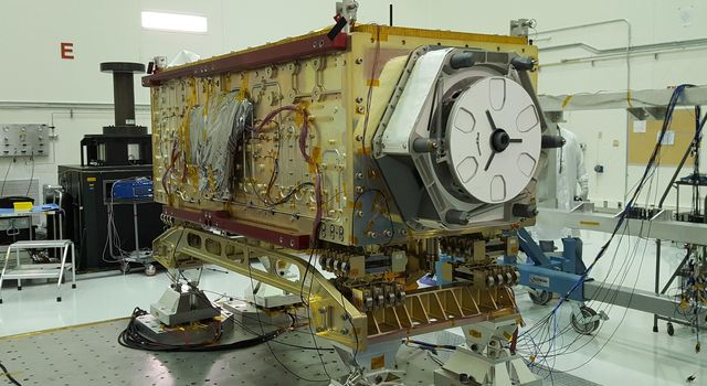 OCO-3 sits on the large vibration table (known as the shaker) in the Environmental Test Lab at the Jet Propulsion Laboratory.