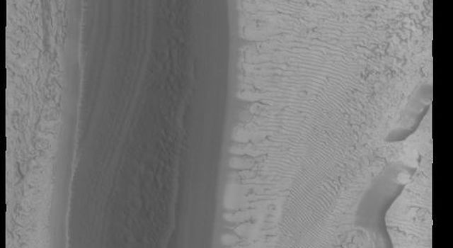 This image from NASAs Mars Odyssey shows part of the south polar cap. This image was taken at the end of southern summer.