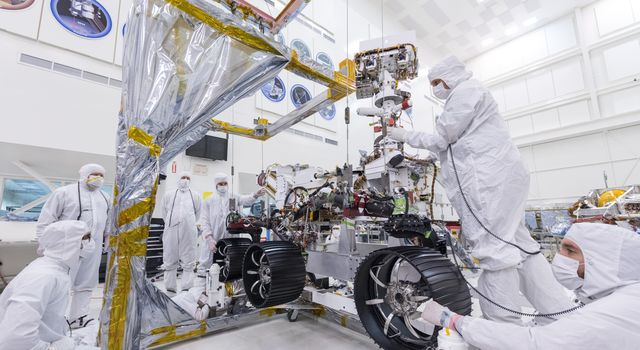 In this image, taken on June 13, 2019, engineers at JPL install the starboard legs and wheels on NASAs Mars 2020 rover.